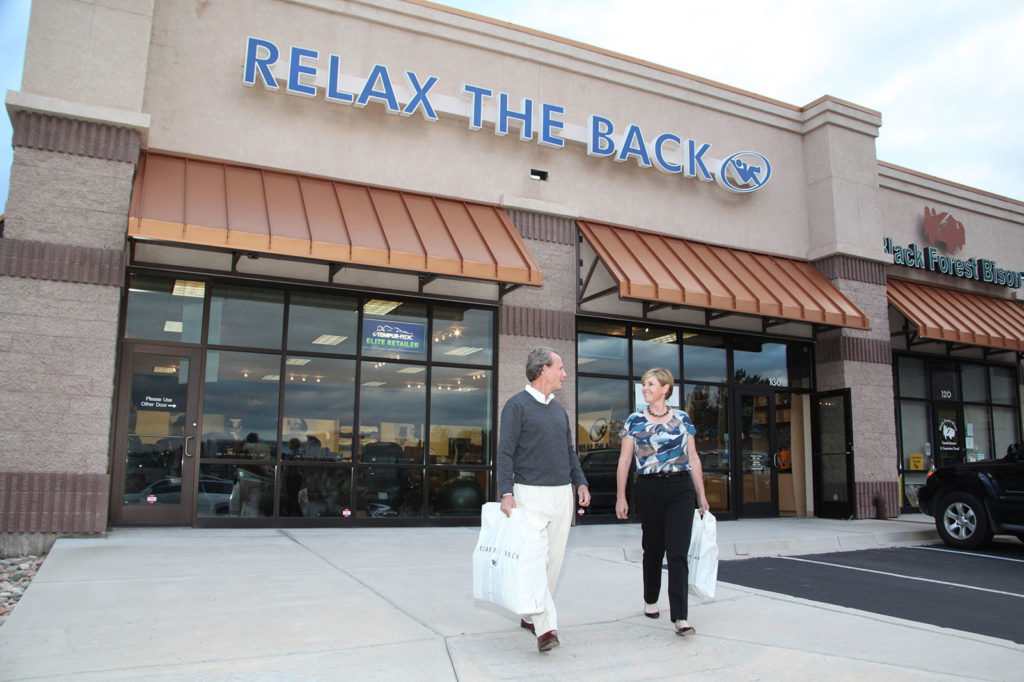 shoppers leaving relax the back wellness franchise location