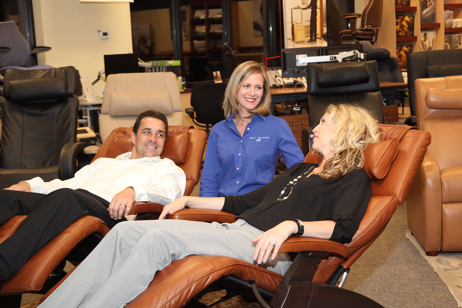 couple enjoying product at relax the back wellness franchise store